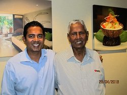 Pacific hotel industry doyen Y P Reddy (right) with son Rohit at the Tano Group's offices in Auckland.