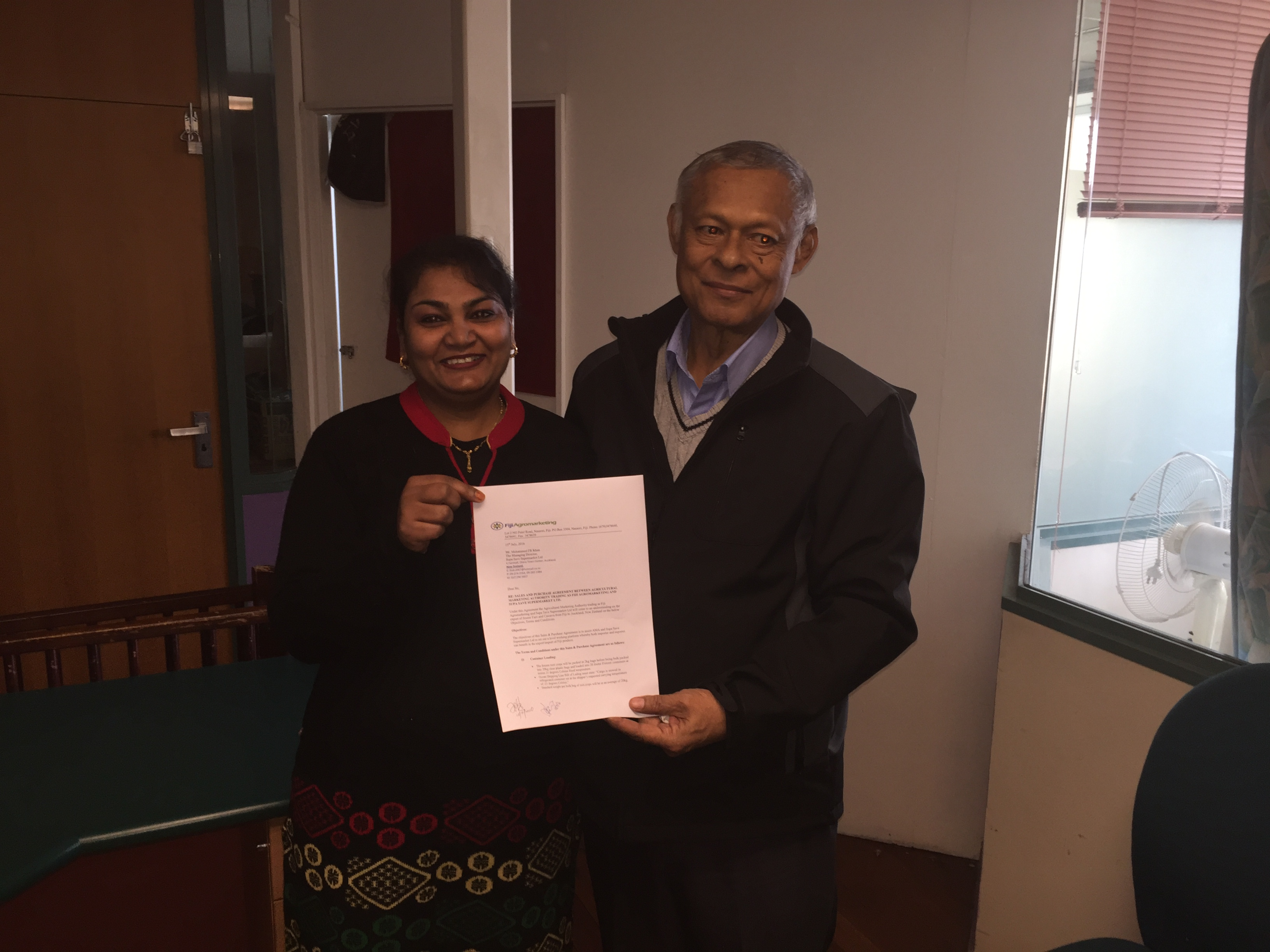 Ms Saleshni Khan and Mr Mohammed Khan with the signed agreement.