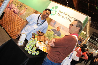 PT&I NZ's Joe Fuavao talks to a visitor at the PT&I Pacific Islands stand at the Fine Food NZ Show in Auckland last week.