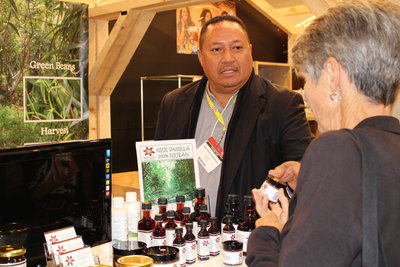 Stanley Kalauni talks to a customer at the show.