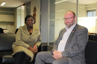 Michael Greenslade PT&I NZ Trade Commissioner with Ms Chigwada at the Auckland office.