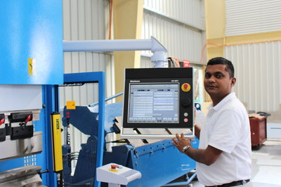 Kevi Reddy at the controls of a state of the art CNC machine in Nadi.