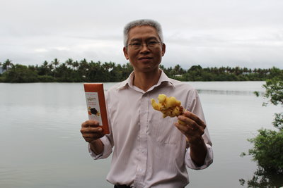 Calvin Qiu of Kaiming Agro with the ginger that adds spice to New Zealand's popular Whittaker's chocolate.