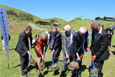 NZ Prime Minister John Key (third from left) and other dignitaries turn the sod at the spot where the Hawaiki cable will make landfall on a beach in Northland, New Zealand